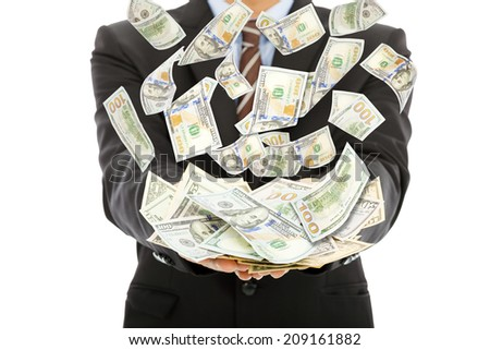 businessman earns us dollar with money rain - stock photo