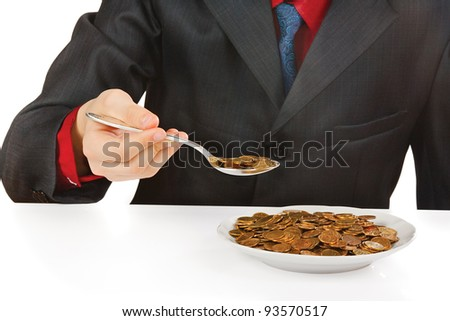 Businessman eating money on a white background - stock photo