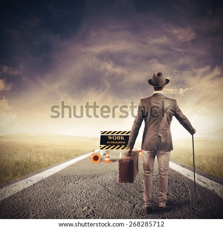 Businessman encounters an obstacle in his path - stock photo