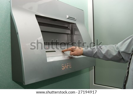businessman entering the bank safe or secure data by keypad - stock photo