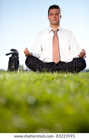Businessman escaped outdoors to relax from his stressful job - stock photo