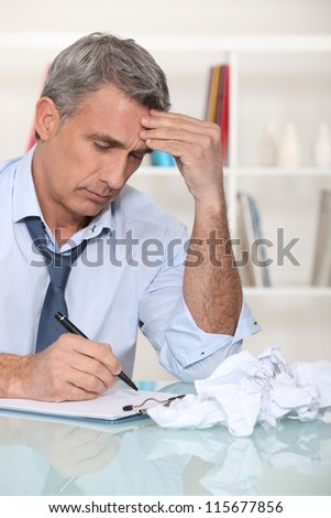 Businessman experiencing writer's  block - stock photo