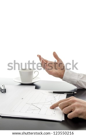 Businessman explaining financial reports on a black desk. With white background. - stock photo