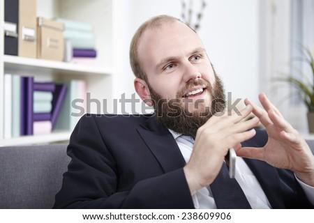 Businessman explaining something, gesturing with hands - stock photo