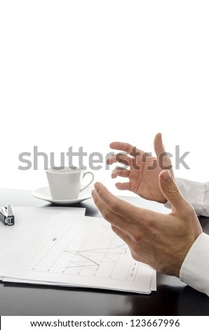 Businessman explaining strategy with financial documents in front of him. - stock photo