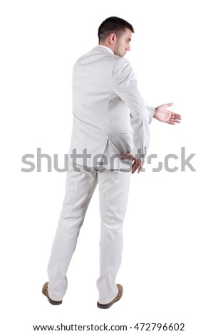 businessman extending hand to shake. Rear view. Isolated over white background.
