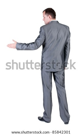businessman extending hand to shake. Rear view. Isolated over white background. - stock photo