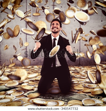 Businessman exults under a rain of money - stock photo