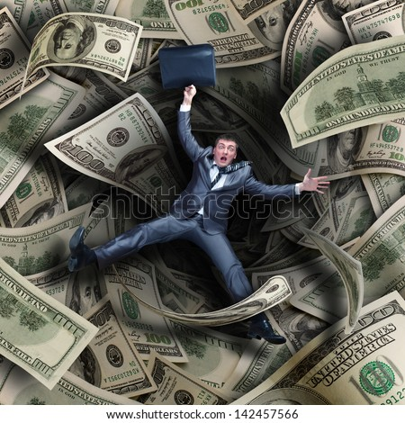 Businessman falling into tunnel of $100 dollar bills - stock photo