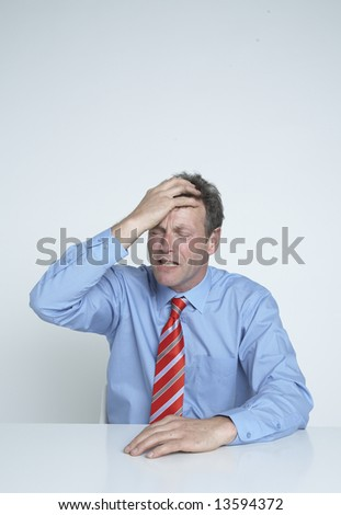 Businessman feels the pressure - stock photo