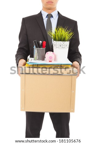 businessman felling sad and carrying his belongings - stock photo