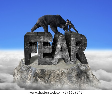 Businessman fighting against black bear on fear 3d mottled concrete word, on top of mountain peak with blue sky cloudscape background - stock photo