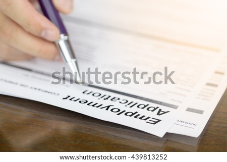 Businessman fill in Employment Application form concept with a pen or job vacancy.