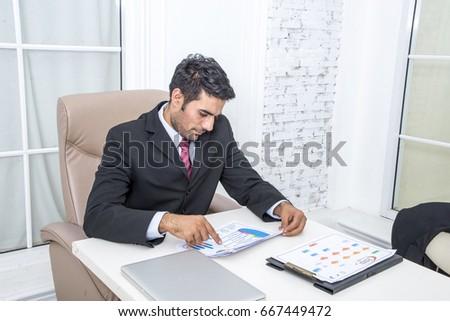 businessman financial inspector making report, calculating or checking balance. Internal Revenue Service inspector checking document