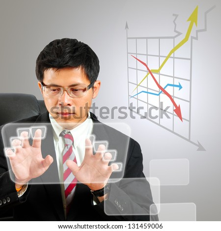 Businessman finger key with touch screen keyboard - stock photo