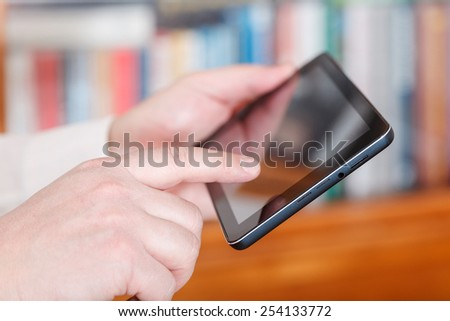 businessman finger touching tablet pc screen in office room - stock photo