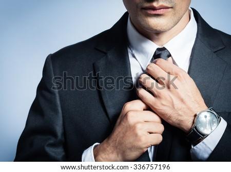 Businessman fixing his tie.  - stock photo