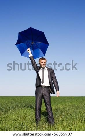 Businessman flying on his umbrella - stock photo