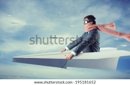 Businessman flying on paper plane - stock photo