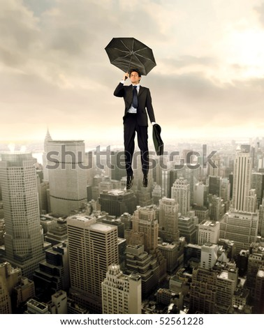 Businessman flying over a cityscape - stock photo