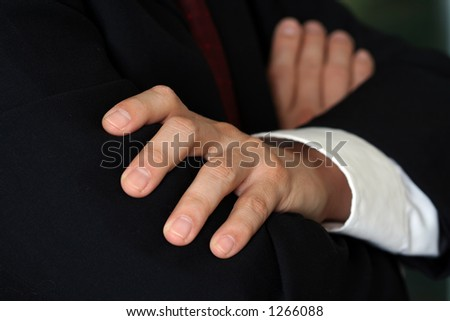 Businessman folding hands - stock photo