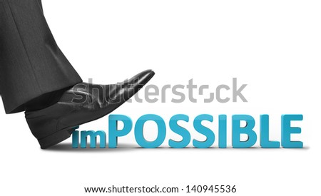 businessman foot crushes impossible text on a white background - stock photo