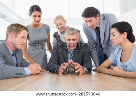 Businessman forecasting the future with his crystal ball in the office - stock photo