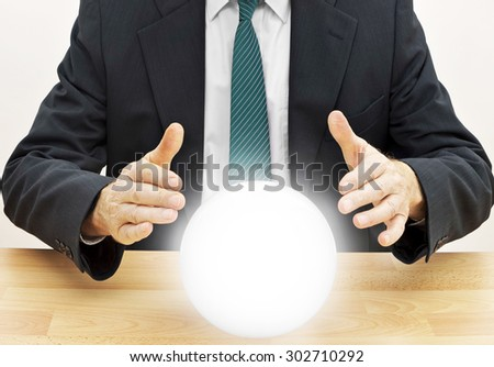 Businessman fortune teller. Budget, financial or investment planning etc. - stock photo