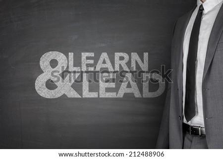 Businessman front of Blackboard - stock photo