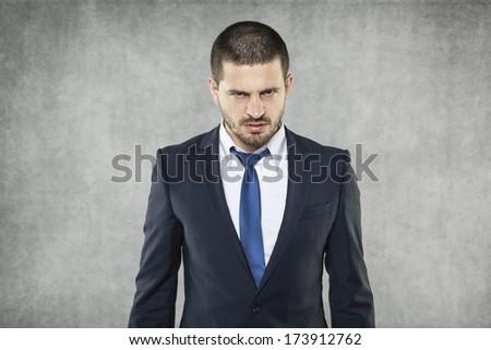 Businessman full of anger - stock photo