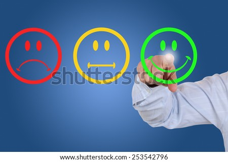 Businessman gives a positive vote for service quality with a green smiley - stock photo