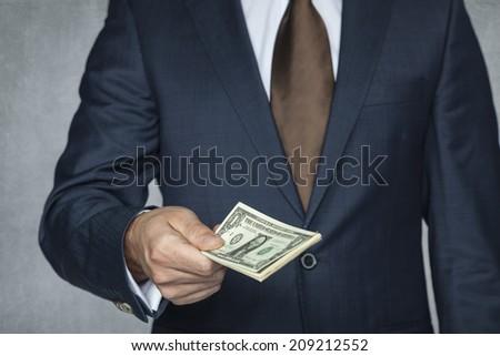 businessman gives money - stock photo