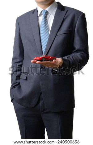 Businessman gives the model car to the customer isolated on white background, sale concept - stock photo