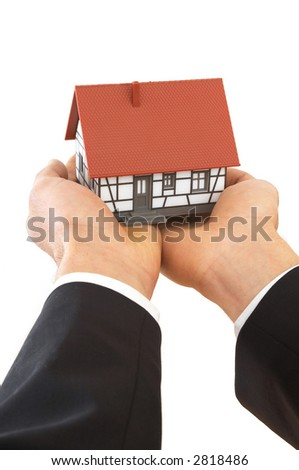 businessman giving a mini house on white