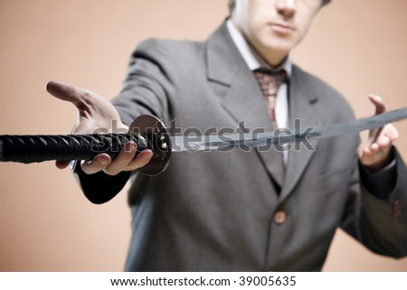 Businessman giving a sword ( symbol of struggle). Partner in business concept, new leader concept - stock photo