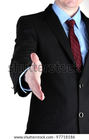 Businessman giving his hand for a handshake isolated on white - stock photo