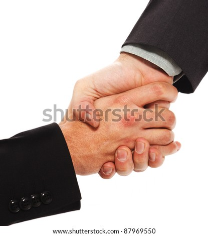 Businessman giving his hand to another one - stock photo