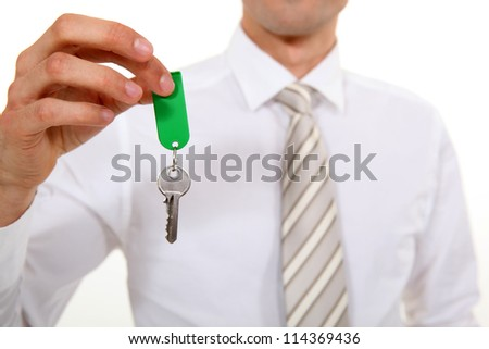Businessman giving key - stock photo