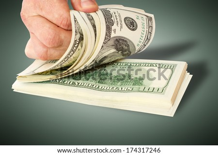 Businessman giving money cash dollars in the hands - stock photo