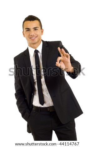Businessman giving OK gesture over white background