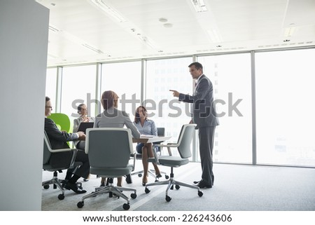 Businessman giving presentation in conference room - stock photo