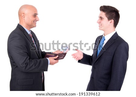 Businessman giving some money to another businessman - stock photo