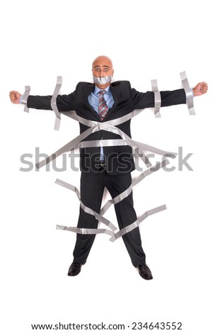 Businessman glued to the wall with duct tape