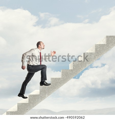 businessman go up on concrete stair in the sky