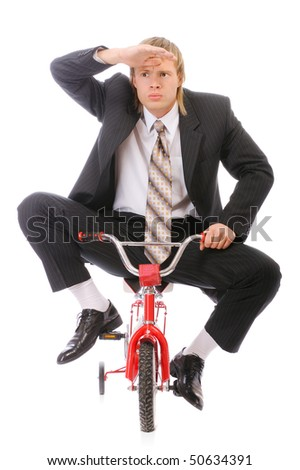 Businessman goes on children's bicycle, isolated on white background. - stock photo