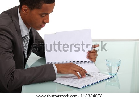 Businessman going over notes - stock photo