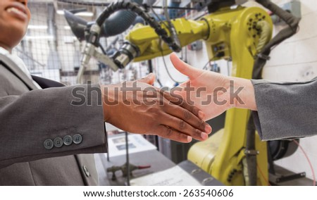 Businessman going shaking a hand against garage - stock photo