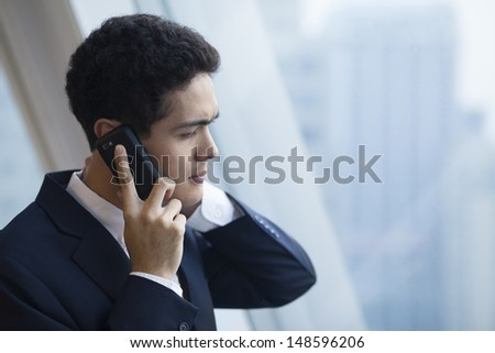 Businessman got a bad news on the phone. - stock photo