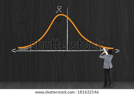 Businessman growing statistic curve graph of Gaussian (bell) function / standard deviation / on a wall - statistical concept - stock photo