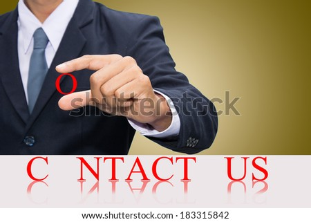 Businessman hand and word Contact us concept.  - stock photo